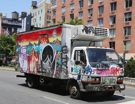 lower east side: NEW YORK - JUNE 16, 2015: Truck covered with graffiti in Lower East Side in Manhattan