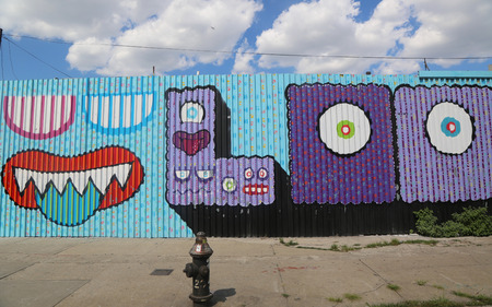 collective: NEW YORK - JULY 23, 2015: Mural art at East Williamsburg in Brooklyn.Outdoor art gallery known as the Bushwick Collective has most diverse collection of street art in Brooklyn