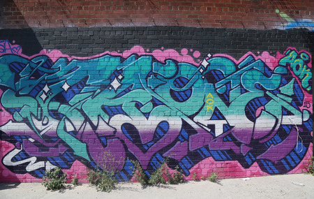 NEW YORK - JULY 23, 2015: Graffiti art at East Williamsburg in Brooklyn.Outdoor art gallery known as the Bushwick Collective has most diverse collection of street art in Brooklyn Reklamní fotografie - 42618731
