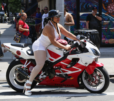 NEW YORK - JULY 11, 2015: Biker girl on a motorcycle at East Harlem in New York