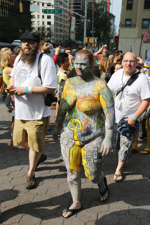 NEW YORK - JULY 18, 2015: Artists paint 100 fully nude models of all shapes and sizes during second NYC Body Painting Day in midtown Manhattan featuring artist Andy Golub in New York