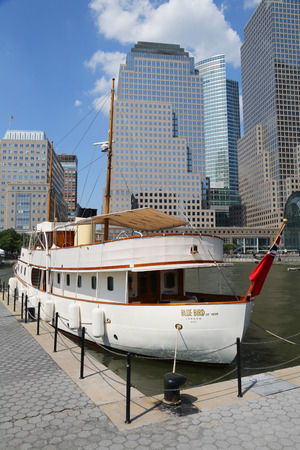 gentleman s: NEW YORK CITY - JULY 11, 2015: Historical Blue Bird of 1938 yacht docked at the North Cove Marina at Battery Park. This classic gentleman s yacht built in 1938 for Sir Malcolm Campbell