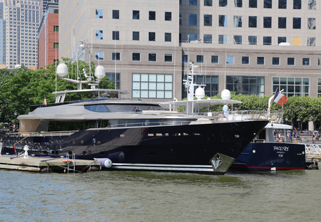 docked: NEW YORK CITY - JULY 11, 2015: Mega yacht docked at the North Cove Marina at Battery Park in Manhattan Editorial