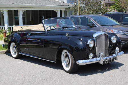 produced: BROOKLYN, NEW YORK - JULY 19, 2015 : 1956 Bentley on display at the Mill Basin car show in Brooklyn, New York . The Bentley S was a luxury car produced by Bentley Motors Limited from 1955 until 1959