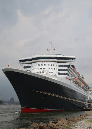 30 s: NEW YORK - JULY 30, 2015: Queen Mary 2 cruise ship docked at Brooklyn Cruise Terminal. Queen Mary 2 is Cunard s flagship