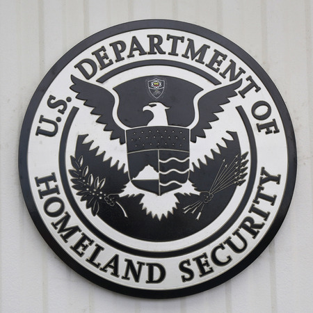 security laws: NEW YORK CITY - JULY 30, 2015: U.S. Department of Homeland Security logo at Brooklyn Cruise Terminal Editorial