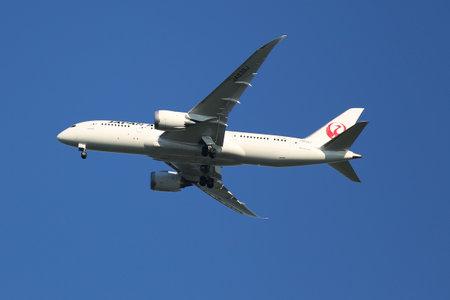 NEW YORK - AUGUST 2, 2015:Japan Airlines Boeing 787 Dreamliner descending for landing at JFK International Airport in New York
