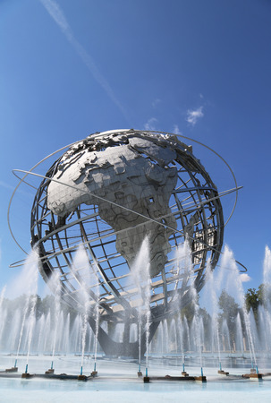 world's: NEW YORK - AUGUST 18, 2014: 1964 New York World s Fair Unisphere in Flushing Meadows Park. It is the worlds largest global structure, rising 140 feet and weighing 700 000 pounds Editorial