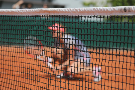 Tennis player at clay court during doubles match