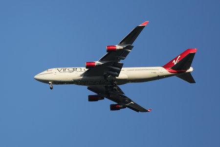 airways: NEW YORK - AUGUST 9, 2015: Virgin Atlantic Airways Boeing 747 descending for landing at JFK International Airport in New York