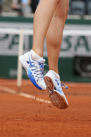 nike: PARIS, FRANCE- MAY 29, 2015:Five times Grand Slam champion Maria Sharapova wears custom Nike shoes during third round match at Roland Garros 2015 in Paris, France