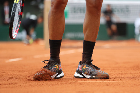 adidas: PARIS, FRANCE- MAY 24, 2015: Professional tennis player Jo-Wilfried Tsonga wears Adidas Y-3 Roland Garros Adizero all-court shoes during first round match at Roland Garros 2015 in Paris, France