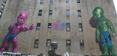 tot: NEW YORK - AUGUST 8, 2015:Temper Tot murals by Ron English in Little Italy in Manhattan. A mural is any piece of artwork painted or applied directly on a wall, ceiling or other large permanent surface