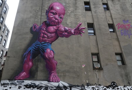 ron: NEW YORK - AUGUST 8, 2015: New giant pink Temper Tot mural by Ron English in Little Italy in Manhattan.