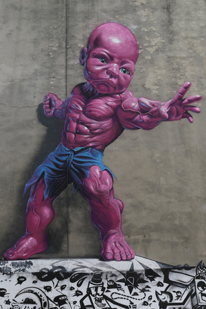 tot: NEW YORK - AUGUST 8, 2015: New giant pink Temper Tot mural by Ron English in Little Italy in Manhattan.