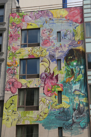 NEW YORK - AUGUST 8, 2015: Mural art at Canal Street in Manhattan. A mural is any piece of artwork painted or applied directly on a wall, ceiling or other large permanent surface