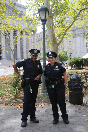 police force: NEW YORK - AUGUST 8, 2015:NYPD officers providing security during Summer Streets Saturday in New York. Summer Streets is an annual celebration of New York City s most valuable public space our streets Editorial