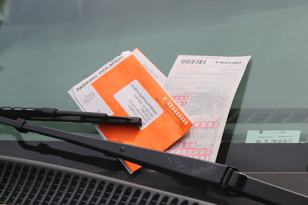 law breaker: NEW YORK - AUGUST 8, 2015: Illegal Parking Violation Citation On Car Windshield in New York