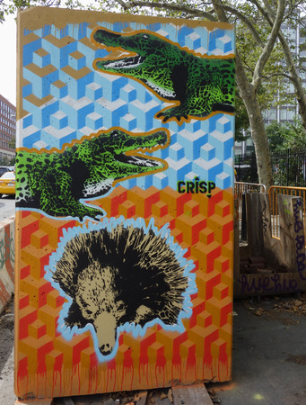 NEW YORK - AUGUST 8, 2015: Mural art at Houston Avenue in Soho. A mural is any piece of artwork painted or applied directly on a wall, ceiling or other large permanent surface Sajtókép