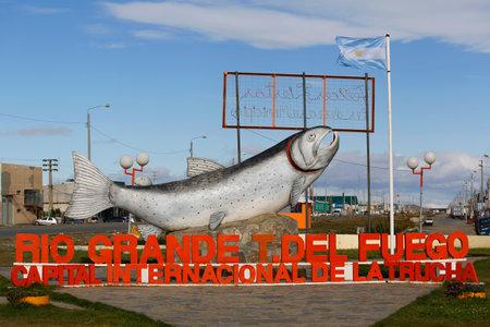 RIO GRANGE, ARGENTINA - APRIL 3, 2015: Sign Rio Grande Trout s International Capital in Rio Grande, Argentina. Rio Grande is a city in Argentina on the Isla Grande de Tierra del Fuego Editorial