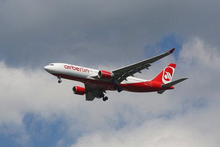 jfk: NEW YORK - AUGUST 13, 2015: Air Berlin Airbus A330 descending for landing at JFK International Airport in New York