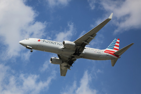american airlines: NEW YORK - AUGUST 13, 2015: American Airlines Boeing 737 descending for landing at JFK International Airport in New York