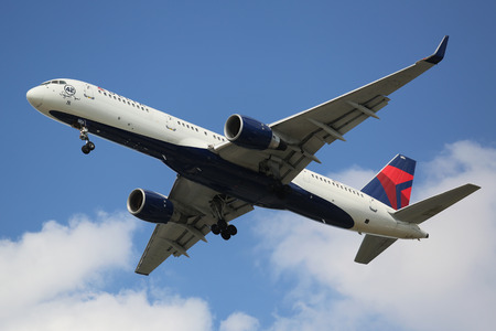 mariano: NEW YORK - AUGUST 13, 2015: Delta Airlines Boeing 757 descending for landing at JFK International Airport in New York. Aircraft named after New York Yankees Hall of Fame Pitcher Mariano Rivera 42