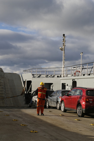 strait of magellan: THE STRAIT OF MAGELLAN, CHILE - APRIL 3, 2015: A board of Fueguino ferry at Bahia Azul, Chile. The ferry is the only way to cross the Straits of Magellan to join the islands of Tierra del Fuego Editorial
