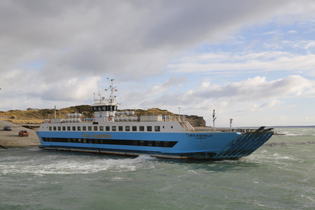 THE STRAIT OF MAGELLAN, CHILE - APRIL 3, 2015: Crux Australis ferry at Bahia Azul, Chile. The ferry is the only way to cross the Straits of Magellan to join the islands of Tierra del Fuego Editorial