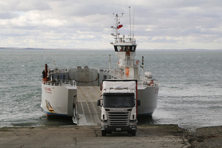 THE STRAIT OF MAGELLAN, CHILE -APRIL 3, 2015:Truck disembarks from Fueguino ferry at Bahia Azul,Chile.The ferry is the only way to cross the Straits of Magellan to join the islands of Tierra del Fuego Editorial