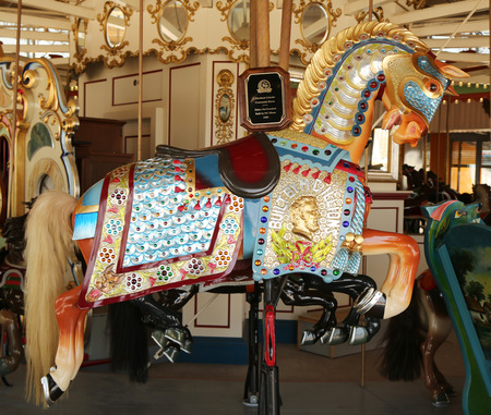 centennial: BROOKLYN, NY - JUNE 7, 2015: Historic Marcus Illions Horse on the BB Carousel. The horse was carved in 1909, the same year the Lincoln penny was issued, in honor of the Centennial of Lincoln s birth