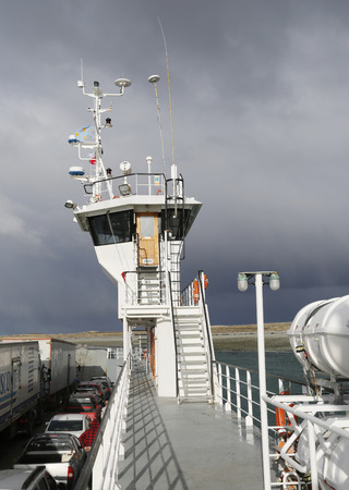 tierra: THE STRAIT OF MAGELLAN, CHILE - APRIL 3, 2015: Fueguino ferry at Bahia Azul, Chile. The ferry is the only way to cross the Straits of Magellan to join the islands of Tierra del Fuego