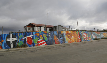 magellan: BAHIA AZUL, CHILE - APRIL 3, 2015: Mural art inspired by Patagonian history near Strait of Magellan ferry at Bahia Azul, Chile Editorial