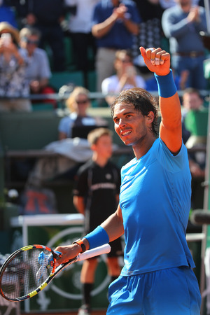nadal: PARIS, FRANCE- MAY 28, 2015:Fourteen times Grand Slam champion Rafael Nadal during second round match at Roland Garros 2015 in Paris, France Editorial