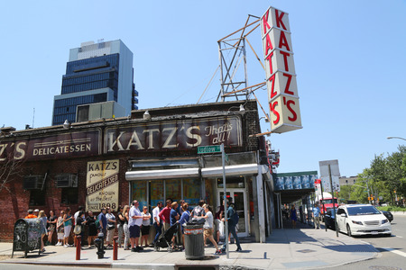 est: NEW YORK - JULY 16, 2015: Long line in the front of the historical Katz s Delicatessen est. 1888, a famous restaurant, known for its Pastrami sandwiches in Lower East Side in Manhattan