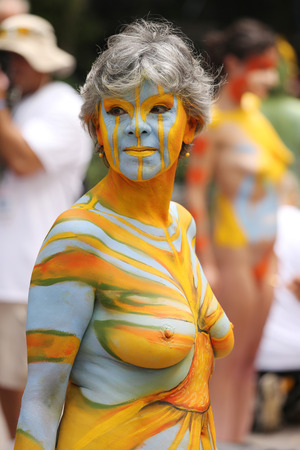 NEW YORK - JULY 18, 2015:Model during second NYC Body Painting Day in midtown Manhattan featuring artist Andy Golub in New York.Artists paint 100 fully nude models of all shapes and sizes during event