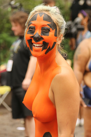 nude young: NEW YORK - JULY 18, 2015:Model during second NYC Body Painting Day in midtown Manhattan featuring artist Andy Golub in New York.Artists paint 100 fully nude models of all shapes and sizes during event