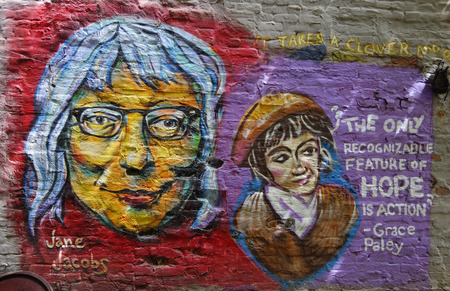 lower section view: NEW YORK - JULY 16, 2015: Mural art inspired by American Women in Lower Manhattan. A mural is any piece of artwork painted or applied directly on a wall, ceiling or other large permanent surface Editorial