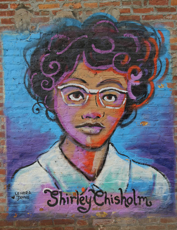 NEW YORK - JULY 16, 2015: Mural art inspired by American Women in Lower Manhattan. A mural is any piece of artwork painted or applied directly on a wall, ceiling or other large permanent surface Sajtókép