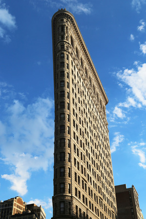 NEW YORK CITY - AUGUST 1, 2015: Historic Flatiron Building in Manhattan.This iconic triangular building located in Manhattan s Fifth Ave was completed in 1902 Publikacyjne