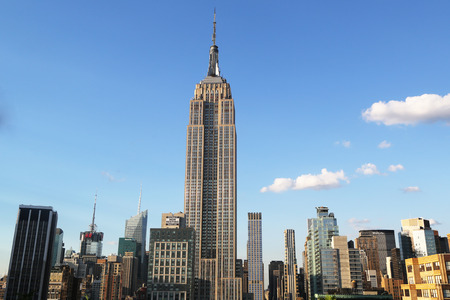 empire state building: NEW YORK - AUGUST 1, 2015: Midtown Manhattan aerial view with Empire State Building. The Empire State Building is a 102-story landmark and was world s tallest building for more than 40 years. Editorial
