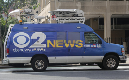 eyewitness: NEW YORK - AUGUST 6, 2015: CBS Channel 2 HD News van in Manhattan. WCBS-TV, channel 2, is the flagship station of the CBS Television Network, located in New York City
