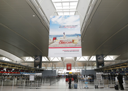 jfk: NEW YORK- MARCH 31, 2015: Inside of Delta Airline Terminal 4 at JFK International Airport in New York. JFK is one of the biggest airports in the world with 4 runways and 8 terminals