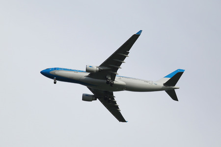 best travel destinations: NEW YORK - AUGUST 23, 2015:Aerolineas Argentinas Airbus A330 descending for landing at JFK International Airport in New York Editorial