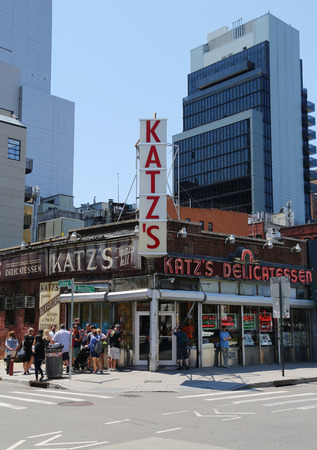 est: NEW YORK - JULY 16, 2015: Long line in the front of the historical Katzs Delicatessen est. 1888, a famous restaurant, known for its Pastrami sandwiches in Lower East Side in Manhattan