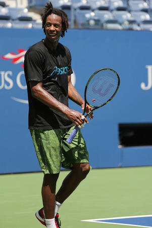 billie: NEW YORK - AUGUST 25, 2015: Professional tennis player Gael Monfis of France  practices for US Open 2015 at Billie Jean King National Tennis Center in New York