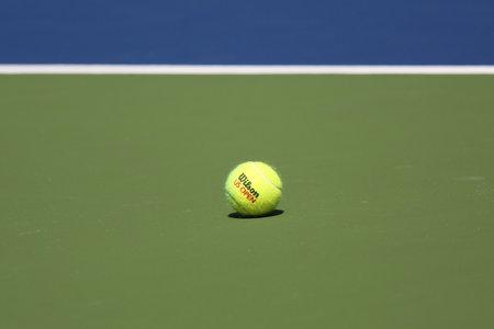 wilson: NEW YORK - AUGUST 25, 2015: US Open Wilson tennis ball at Billie Jean King National Tennis Center in New York. Wilson is the Official Ball of the US Open since 1979 Editorial