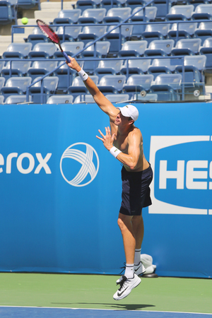 billie: NEW YORK - AUGUST 27, 2015: Professional tennis player John Isner of United States practices for US Open 2015 at Billie Jean King National Tennis Center in New York Editorial