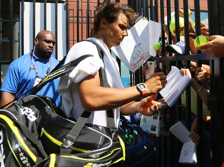champion spain: NEW YORK - AUGUST 27, 2015: Fourteen times Grand Slam champion Rafael Nadal of Spain signing autographs after practice for US Open 2015 at Billie Jean King National Tennis Cente in New York