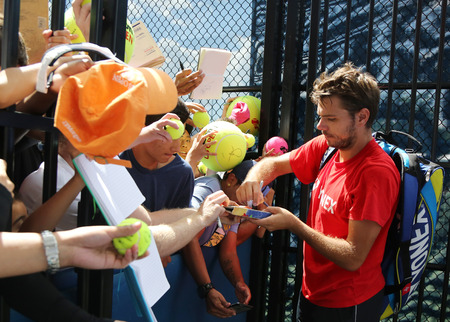 billie: NEW YORK - AUGUST 27, 2015: Two times Grand Slam champion Stanislas Wawrinka of Switzerland signing autographs after practice for US Open 2015 at Billie Jean King National Tennis Center in New York Editorial